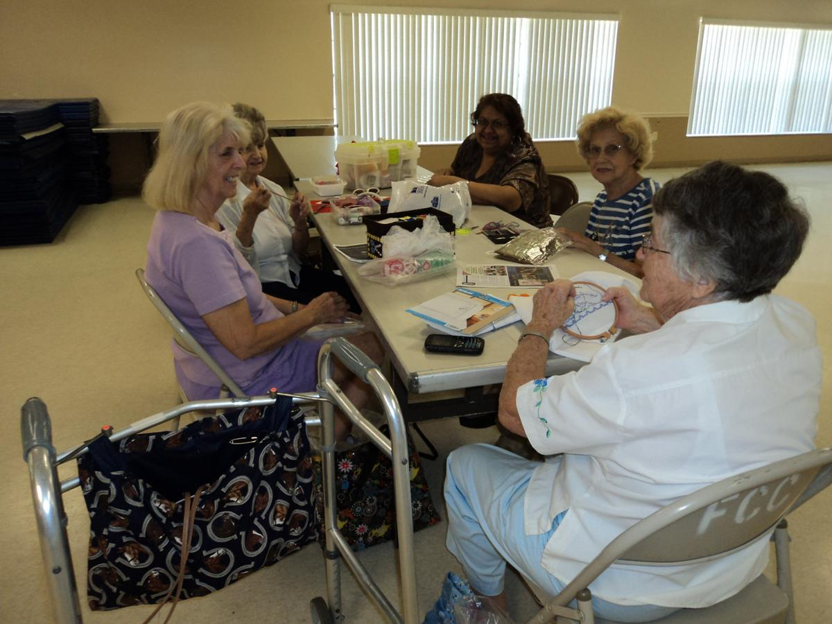 Group of senior citizens making crafts.