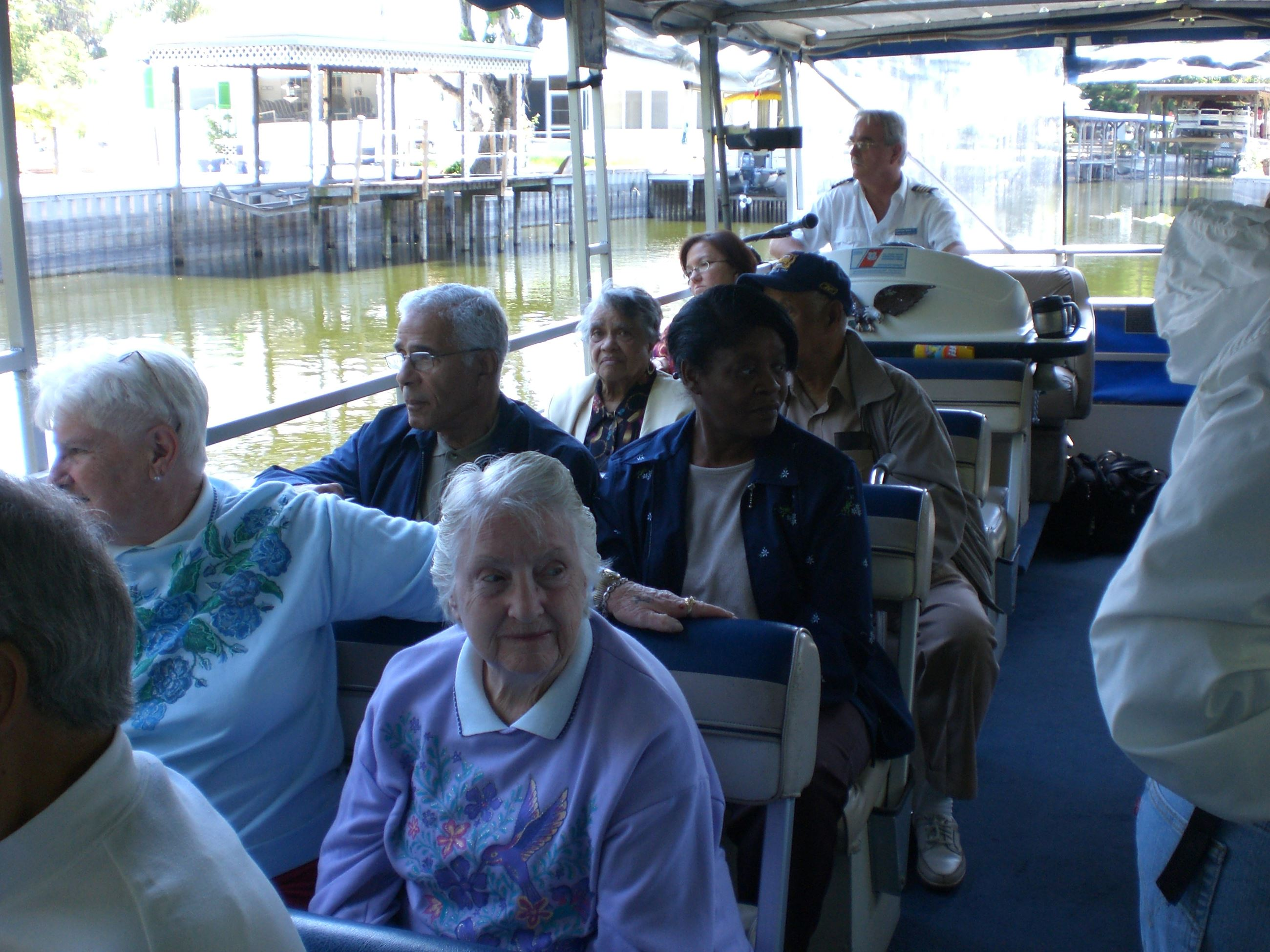 Group of senior citizens on a boat tour.